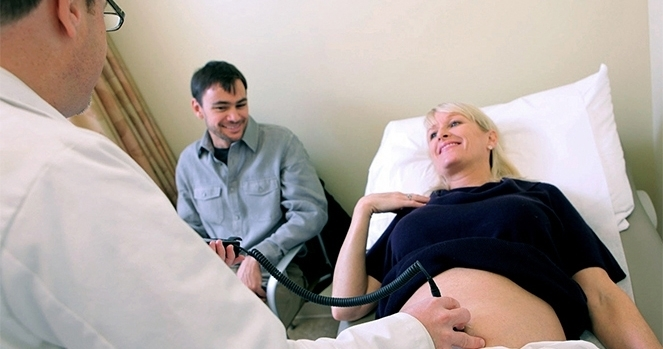 Doctor treats a pregnant woman.