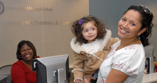 Woman brings her daughter to front desk.